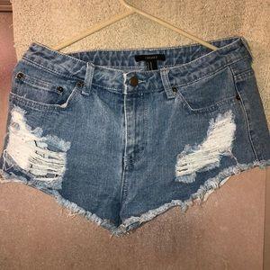 Pants - Medium washed distressed denim jeans